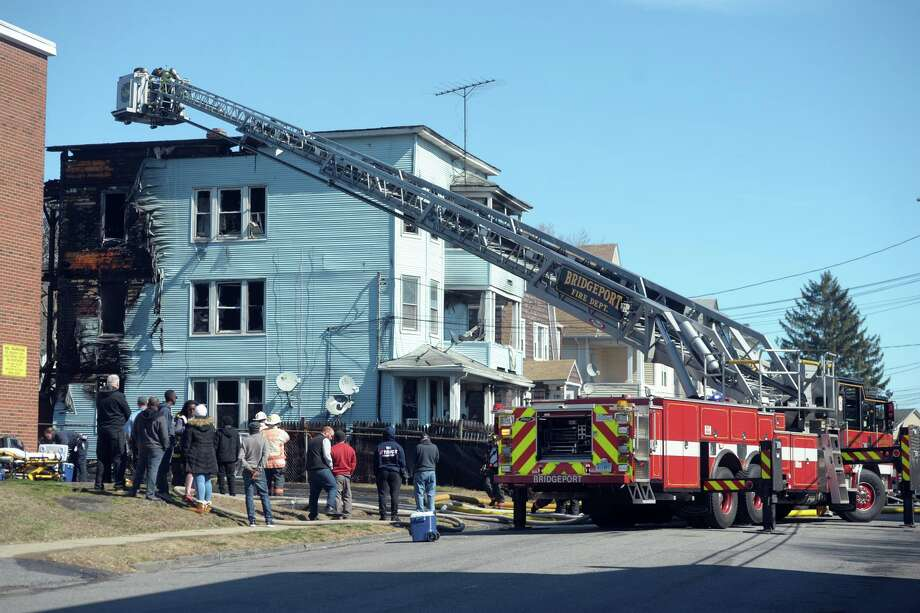 The Bridgeport Fire Department on the scene following a fire in a multi-family home on Hansen Ave., in Bridgeport, Conn. March 5th, 2020. Photo: Ned Gerard / Hearst Connecticut Media / Connecticut Post