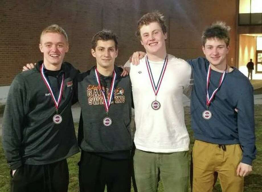 Korey Barber, Matt Cristiano, Ken Walsh and Carson Rhodes set a school record in the 200-yard freestyle relay at the SCC championships. Photo: Christian Abraham / Hearst Connecticut Media / Shelton Herald
