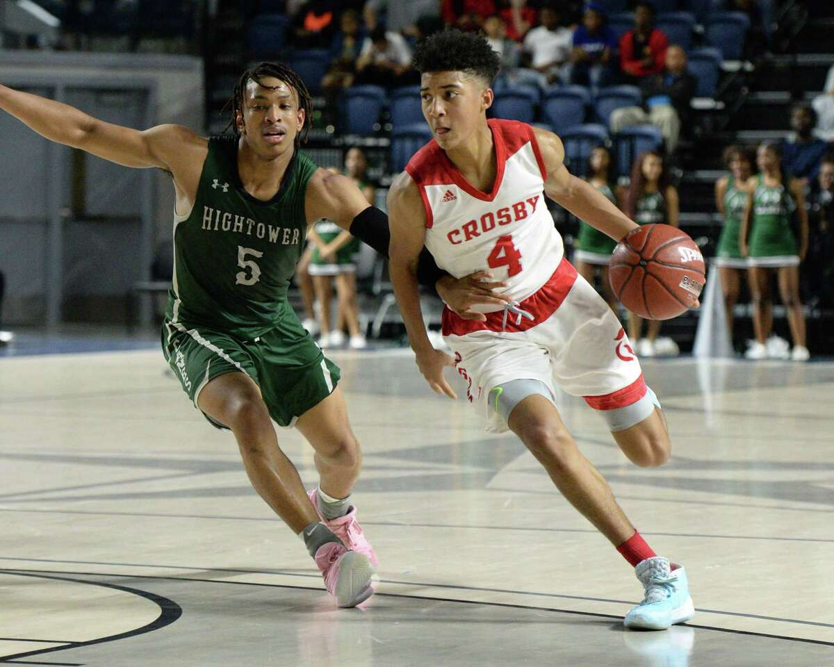 PJ Haggerty (4) of Crosby drives toward the paint during the fourth quarter of the Boys 5A Region III Quarterfinal basketball game between the Hightower Hurricanes and the Crosby Cougars on Tuesday, March 3, 2020 at Delmar Fieldhouse, Houston, TX.