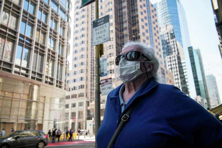 One reader blames the spread of COVID-19 on coddled immune systems; another wants the president to focus on facts. Mean- while, a San Francisco pedestrian  puts her trust in a face mask. Photo: David Paul Morris / Bloomberg / © 2020 Bloomberg Finance LP