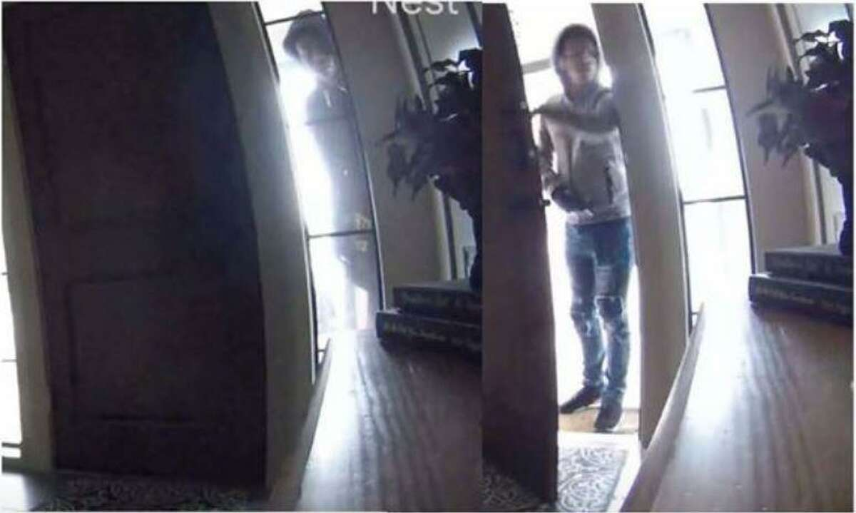 A pair of hooded individuals are seen on surveillance footage during what authorities are saying was a break in of a Spring home where firearms were stolen.