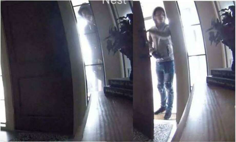 A pair of hooded individuals are seen on surveillance footage during what authorities are saying was a break in of a Spring home where firearms were stolen. Photo: Courtesy Of Montgomery County Sheriff's Office