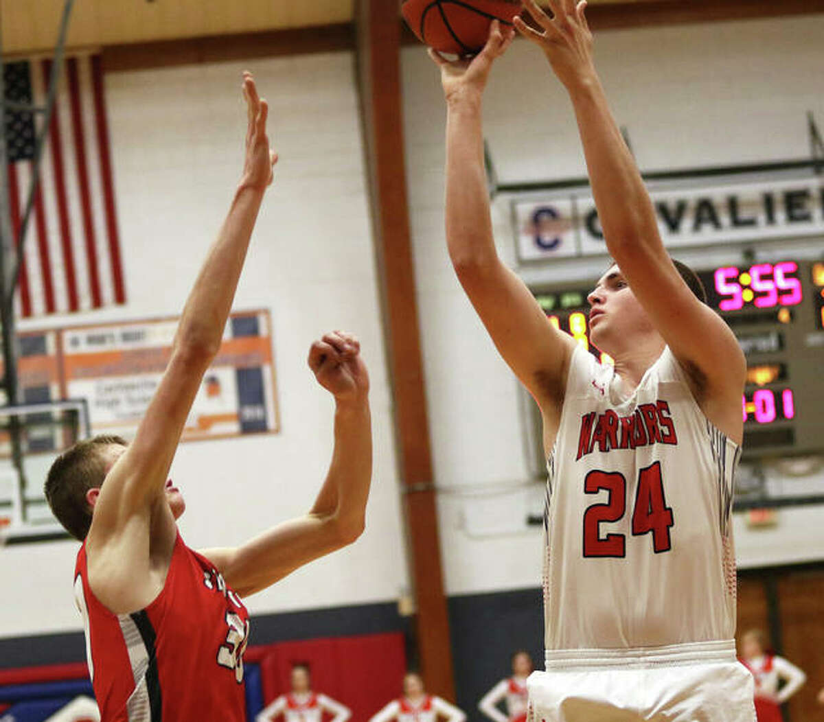 Calhoun's Ben Eberlin (24) shoots over Staunton's Ethan Booth during the Dec. 30 title game at the Carlinville Tournament.