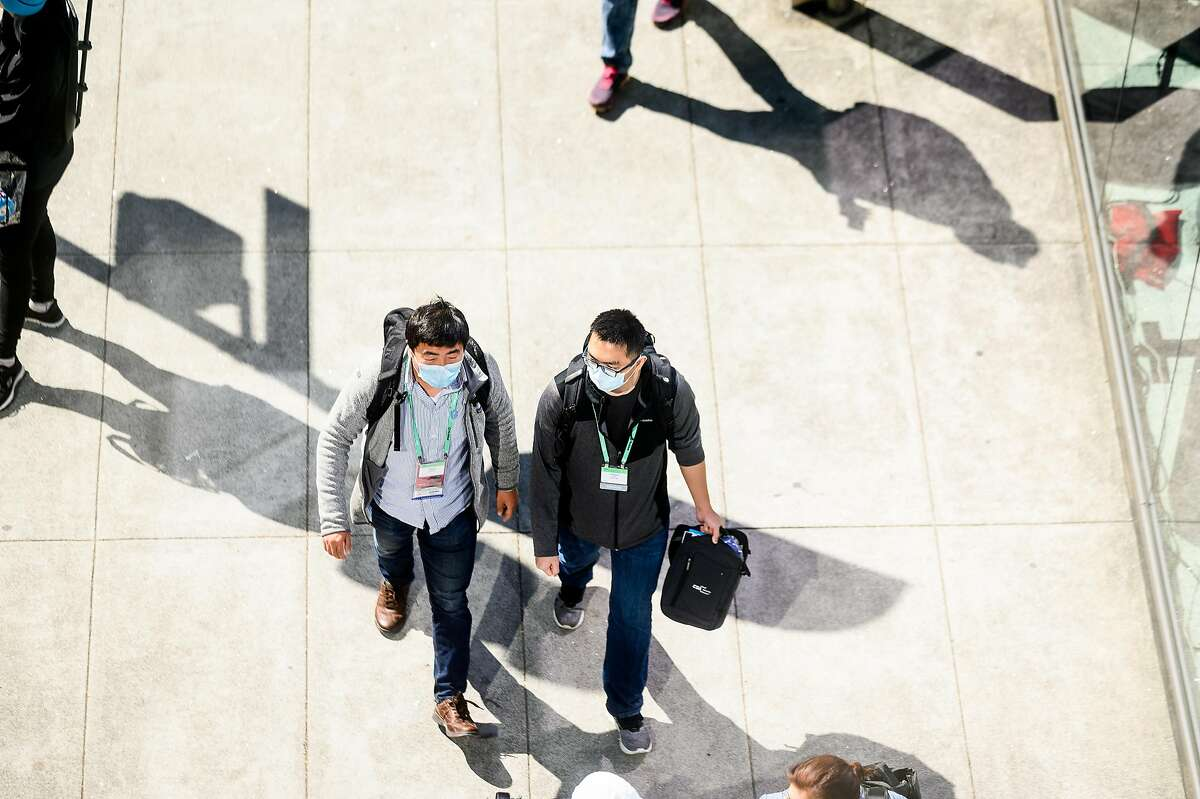 An RSA conference participant wears a mask while crossing between buildings at Moscone Center on Monday, Feb. 24, 2020, in San Francisco.