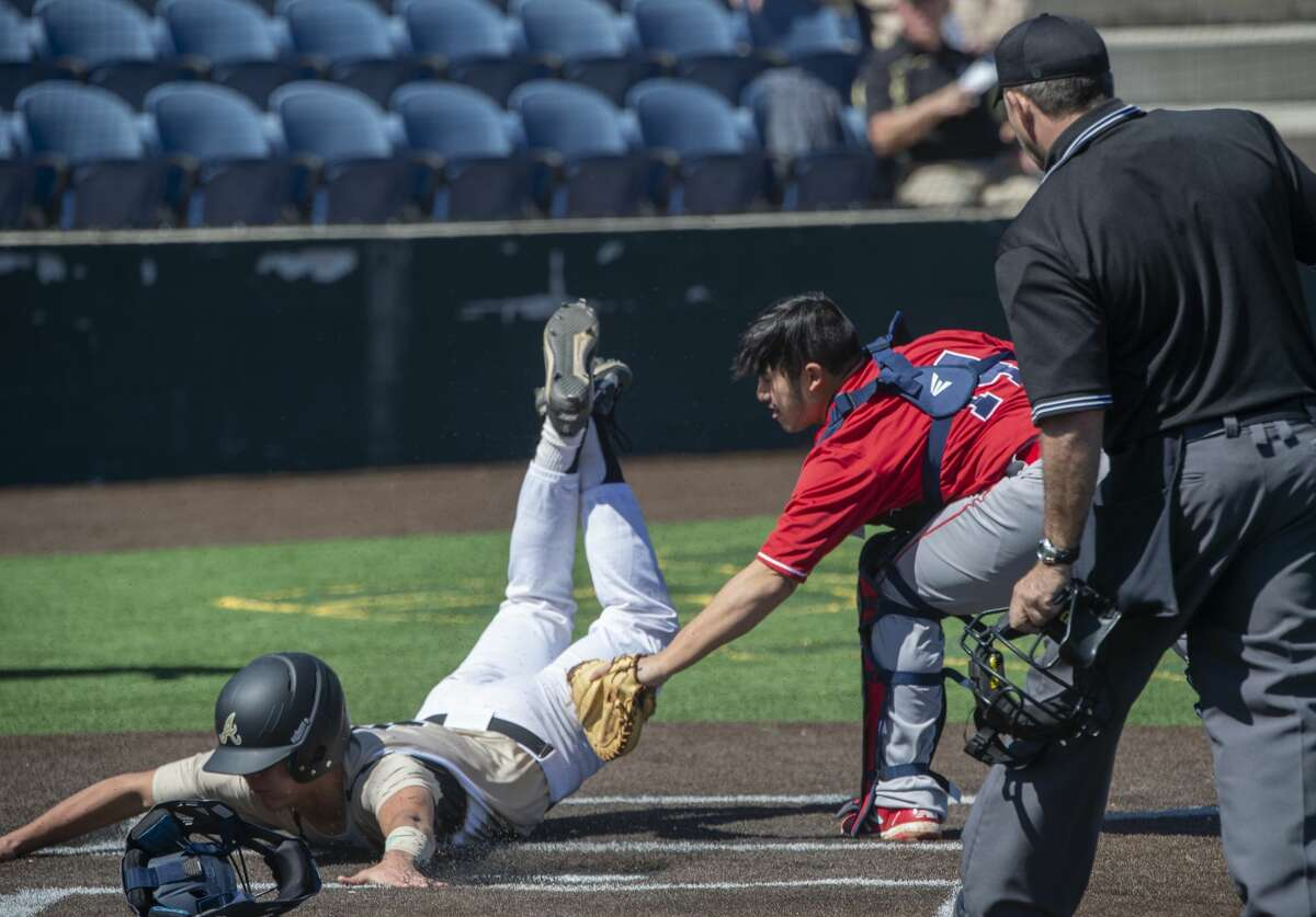 Andrews' Brock Tijerina safely slides across home as Plainview's Isaac Garza is late to make the tag 03/05/2020 at Christensen Stadium during the Tournament of Champions. Tim Fischer/Reporter-Telegram