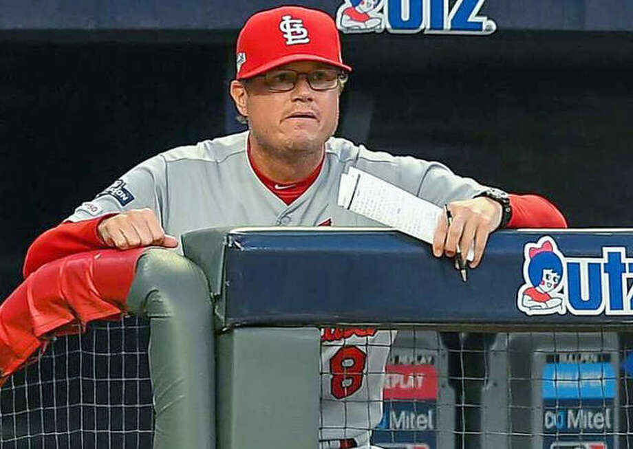 Cardinals manager Mike Schildt will trade the crack of bats for the clang of bells on Friday, when he will get married before returning to the ballpark on Saturday to manage again. Photo: AP Photo