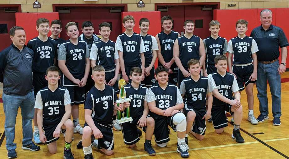 St. Mary team members are Josh Aspden, Chase Bryant, Christopher Deprofio, Gauge Forget, John Gerrity, Dylan Gregory, Chris Harry, Marko Joksovic, Daniel Kron, Max Lula, Derek Rainey, Michael Roney, Matt Savo, Jake Stash, Peter Swanon, Tim Swanson, Will Swanson and A.J. Tkacs. The GNHVAL title winners are coached by Carl DeProfio and Eric Swanson. Photo: Contributed Photo / St. Mary School / Milford Mirror