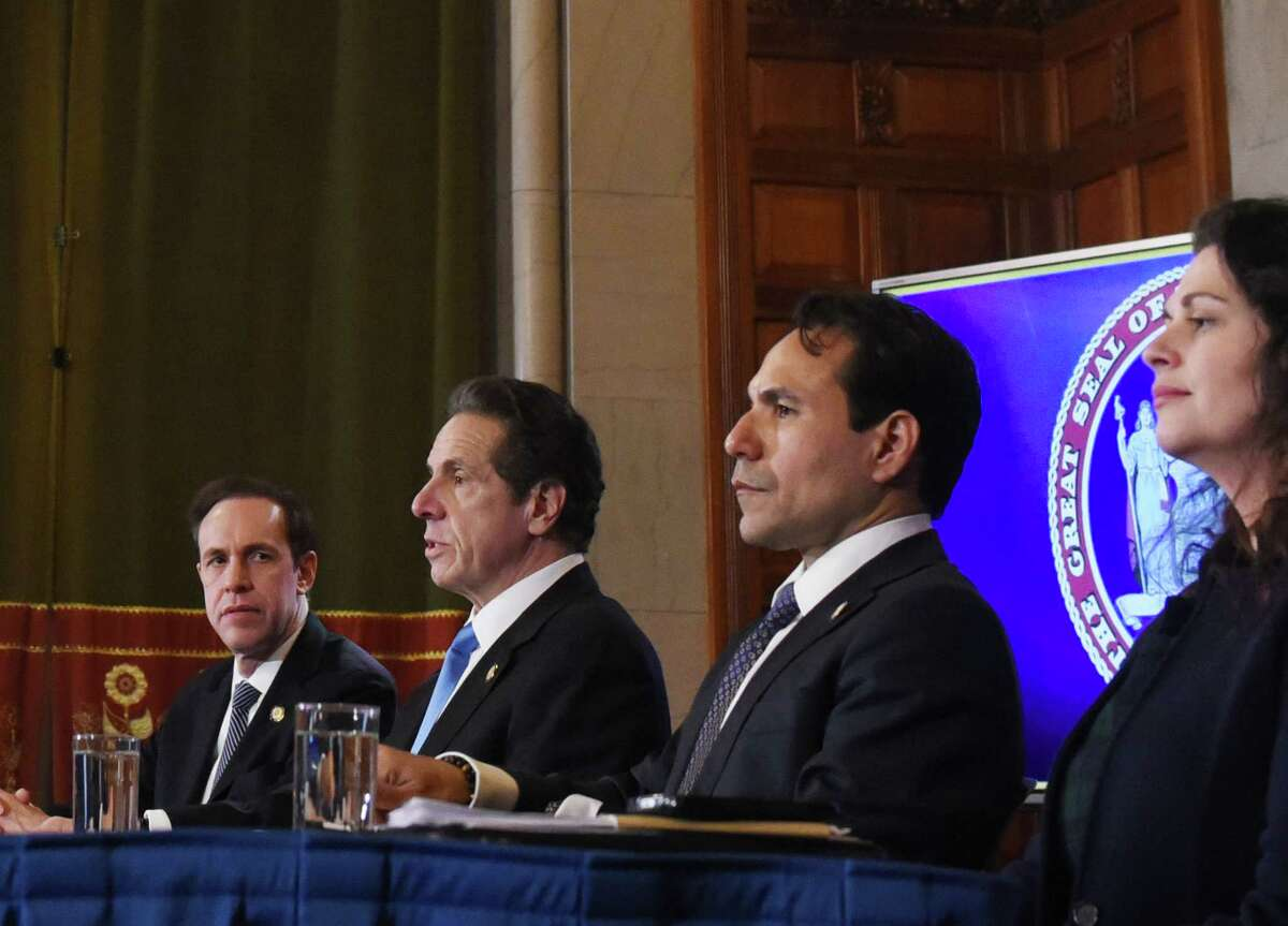 Gov. Andrew Cuomo, second from left, is joined by State Department of Health Commissioner Dr. Howard Zucker, left, budget director Robert Mujica, second from right, and Beth Garvey, special council and senior advisor, right, during a news briefing on state coronavirus cases, and efforts being taken to contain an outbreak on Thursday, March 5, 2020, in the Red Room at the Capitol in Albany, N.Y. (Will Waldron/Times Union)