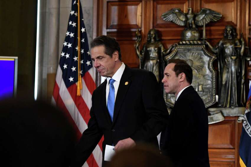 Gov. Andrew Cuomo, left, and State Department of Health Commissioner Dr. Howard Zucker, right, enter the Red Room to conduct a news briefing on state coronavirus cases on Thursday, March 5, 2020, in the Red Room at the Capitol in Albany, N.Y. (Will Waldron/Times Union)