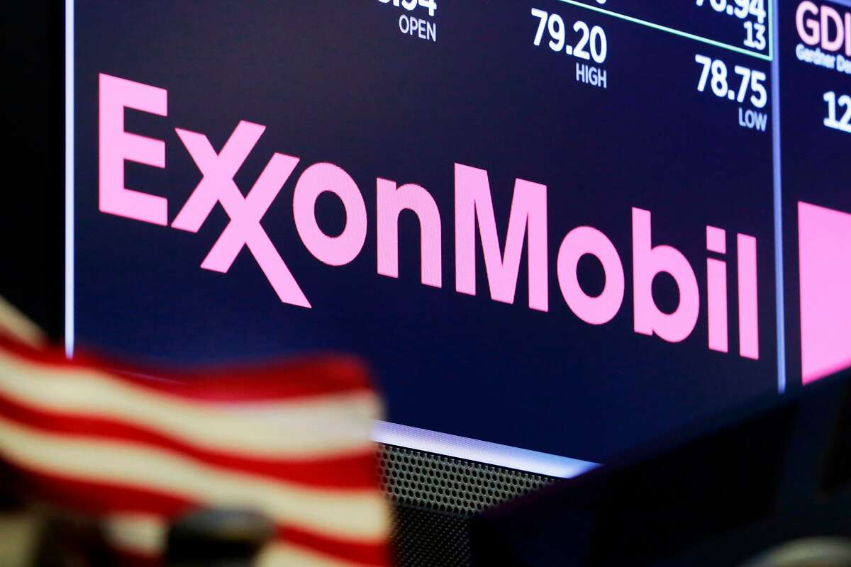FILE - In this April 23, 2018, file photo, the logo for ExxonMobil appears above a trading post on the floor of the New York Stock Exchange.