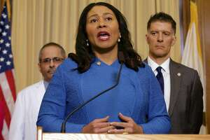 San Francisco Mayor London Breed announces the first confirmed cases of novel coronavirus in the city alongside public health and city officials during a news conference at City Hall in San Francisco, Thursday, March 5, 2020. (Kevin N. Hume/The San Francisco Examiner via AP)