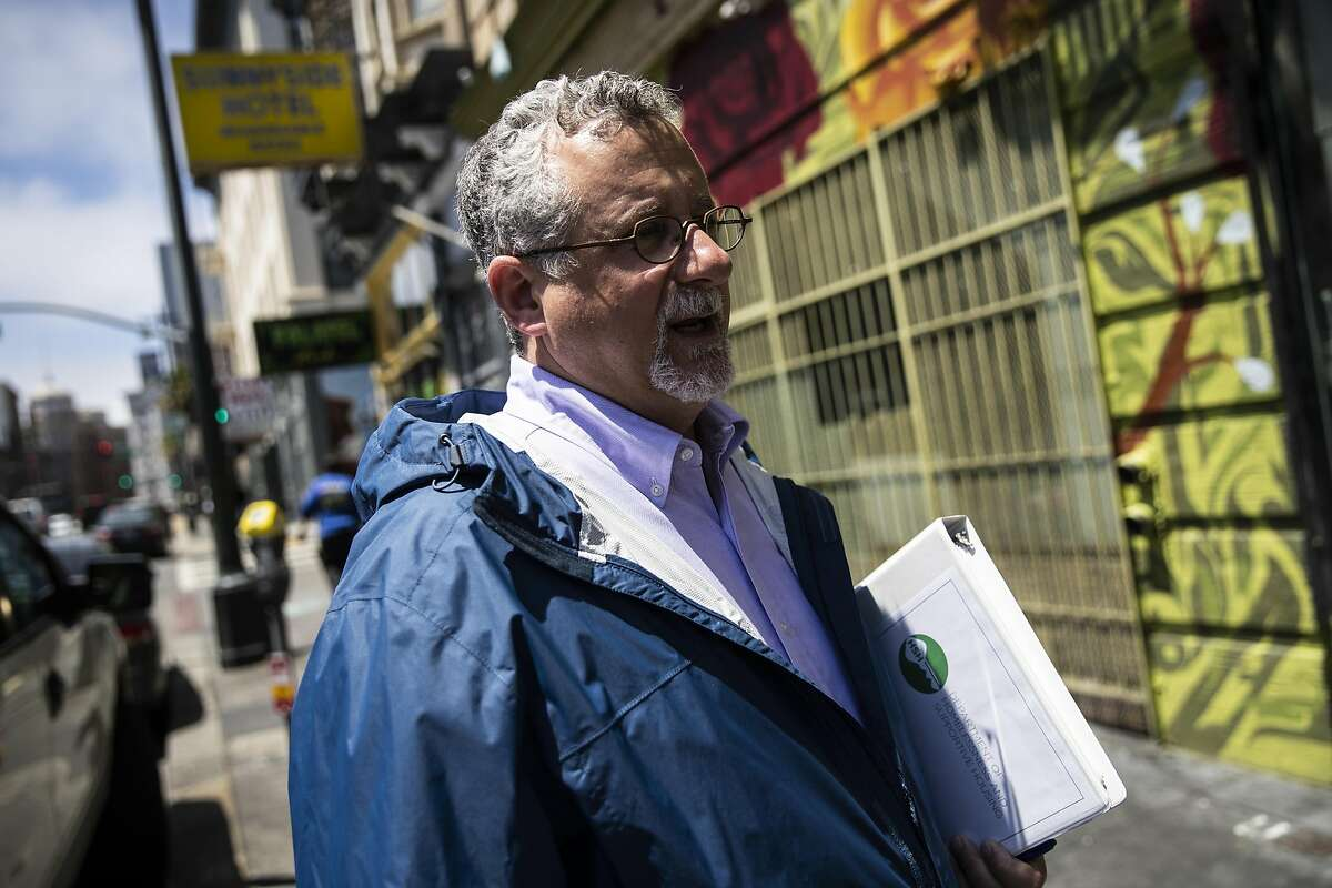 6th St between Minna & Natoma St, 2:11PM: Jeff Kositsky, director of San Francisco Department of Homelessness and Supportive Housing, prepares to go into a meeting at The Minna Lee in San Francisco, Calif. on Tuesday, June 18, 2019.