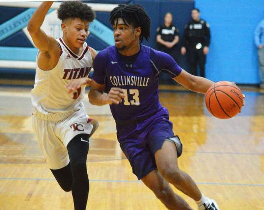 Collinsville senior Ray'Sean Taylor, right, drives to the basket on Jan. 25 during the championship game against Trinity Catholic in the Belleville East Classic. Photo: Scott Marion/The Intelligencer