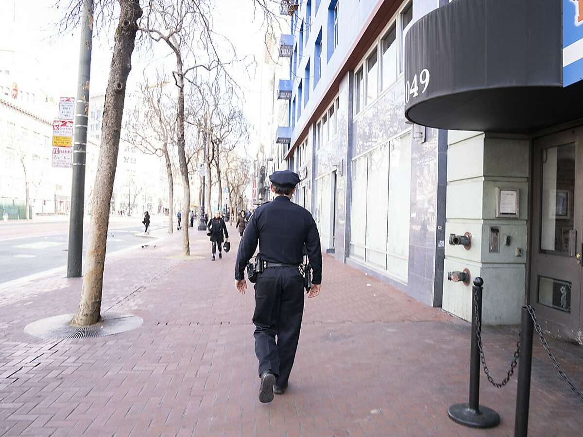 San Francisco police officer Dan Kelly walking his beat across the street from the new police station which opened on Market Street on Tuesday, Feb. 4, 2020.