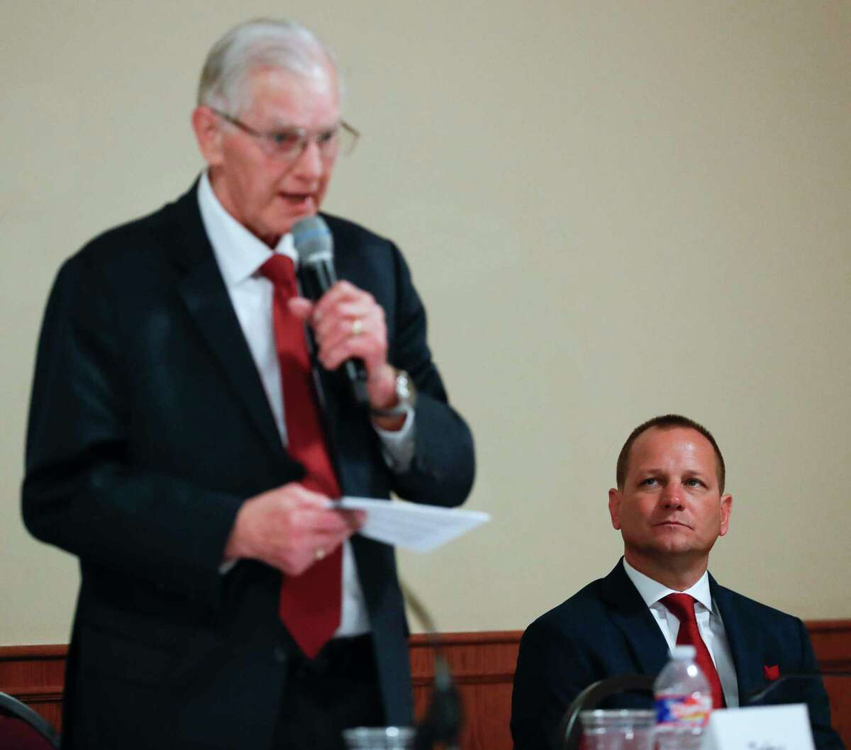 Conroe mayoral candidate Jody Czajkoski, right, listens as incumbent Toby Powell speaks during a Conroe City Council forum at First Baptist Church, Thursday, March 5, 2020, in Conroe. Candidates for mayor, City council Place 1, Place 2 and Place 5 attended the event hosted by the Conroe/Lake Conroe Area Chamber of Commerce.