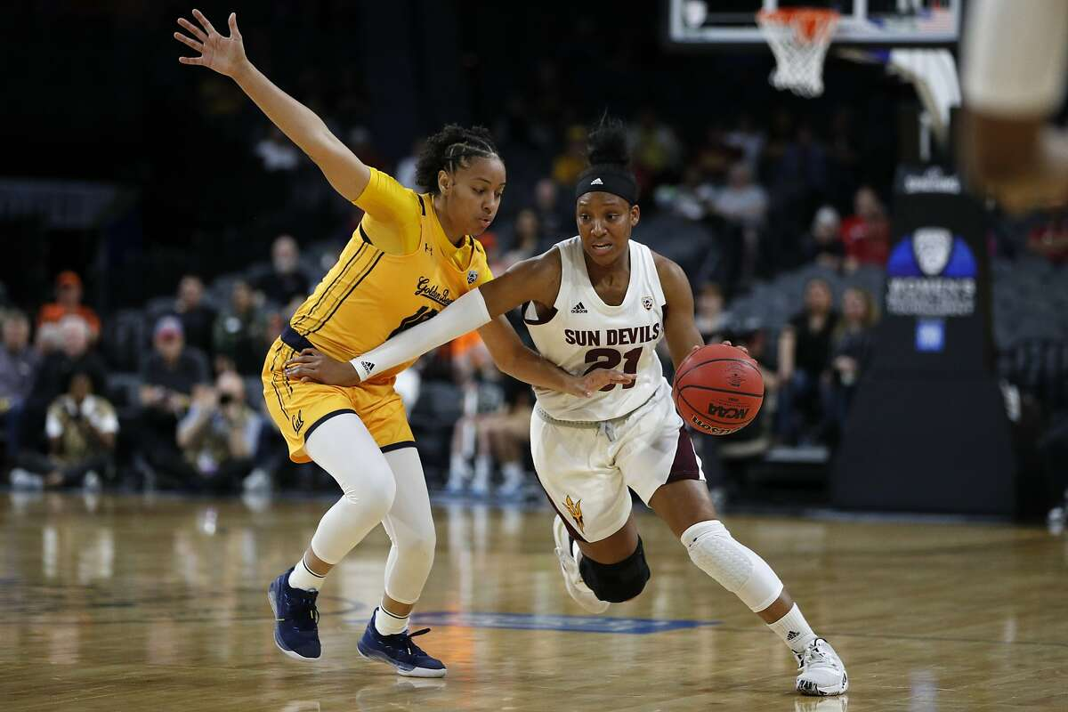 Arizona State's Sydnei Caldwell (21) drives around California's Jazlen Green (10) during the first half of an NCAA college basketball game in the first round of the Pac-12 women's tournament Thursday, March 5, 2020, in Las Vegas. (AP Photo/John Locher)