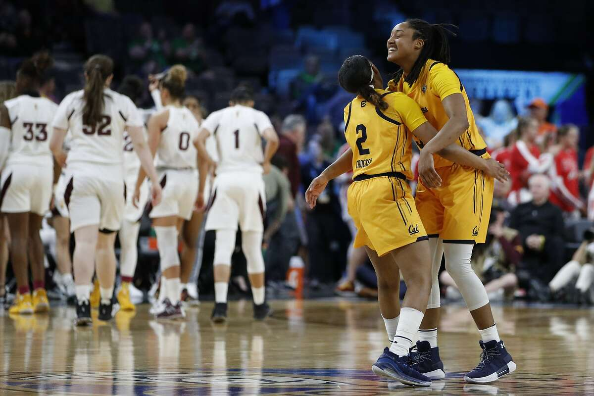 Cal's Cailyn Crocker (2), who had 20 points and six rebounds, hugs Jaelyn Brown (22 points, six rebounds) as they celebrate a big win over Arizona State. The Bears became only the second- ever 12 seed to win a game in the Pac-12 women's tournament.