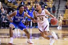 San Marcos, TX; Texas State Bobcats guard Nijal Pearson (22) dribbles the ball as Georgia State Panthers guard Kane Williams (12) defends during the second half at the NCAA mens basketball game on Saturday, Feb 12, 2020, at the Strahan Arena. [JOHN GUTIERREZ/FOR EXPRESS-NEWS]