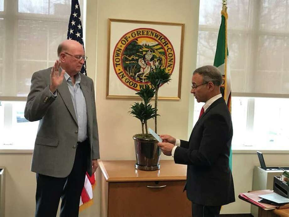 Thomas Smith takes the oath of office from First Selectman Fred Camillo making him a Special Police Officer in the town of Greenwich Photo: / Contributed