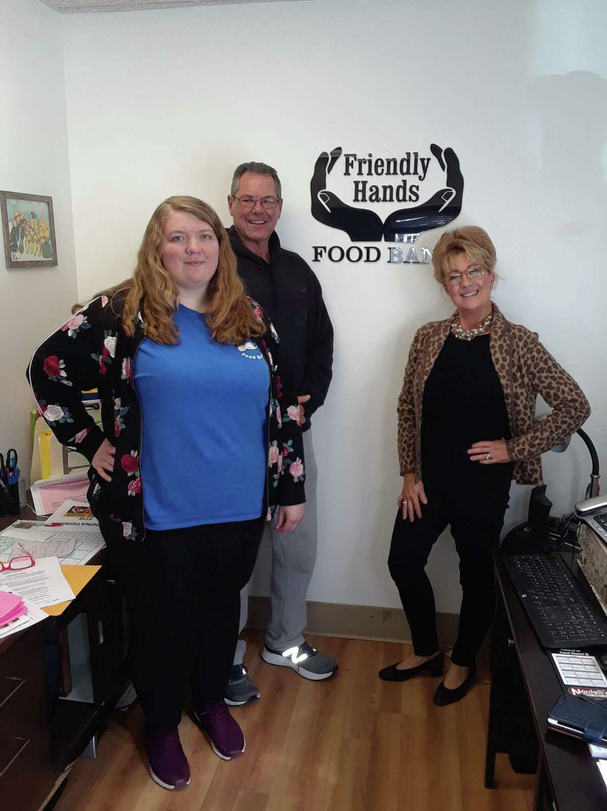 After announcing this week that Friendly Hands Food Bank would close Thursday because of a lack of funding, donations came in, and the food bank is staying open. From left are Friendly Hands secretary Abbey Sekulski, board president Dan Hartnett and director Karen Thomas.