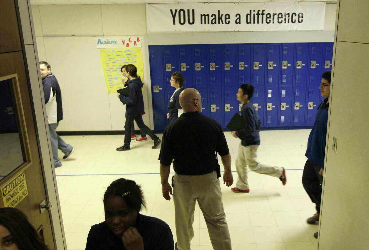 Students make their way down the hall at Ed White Middle School, which uses restorative discipline methods to mediate issues and improve academic performance. But that's not happening at many schools across Texas.