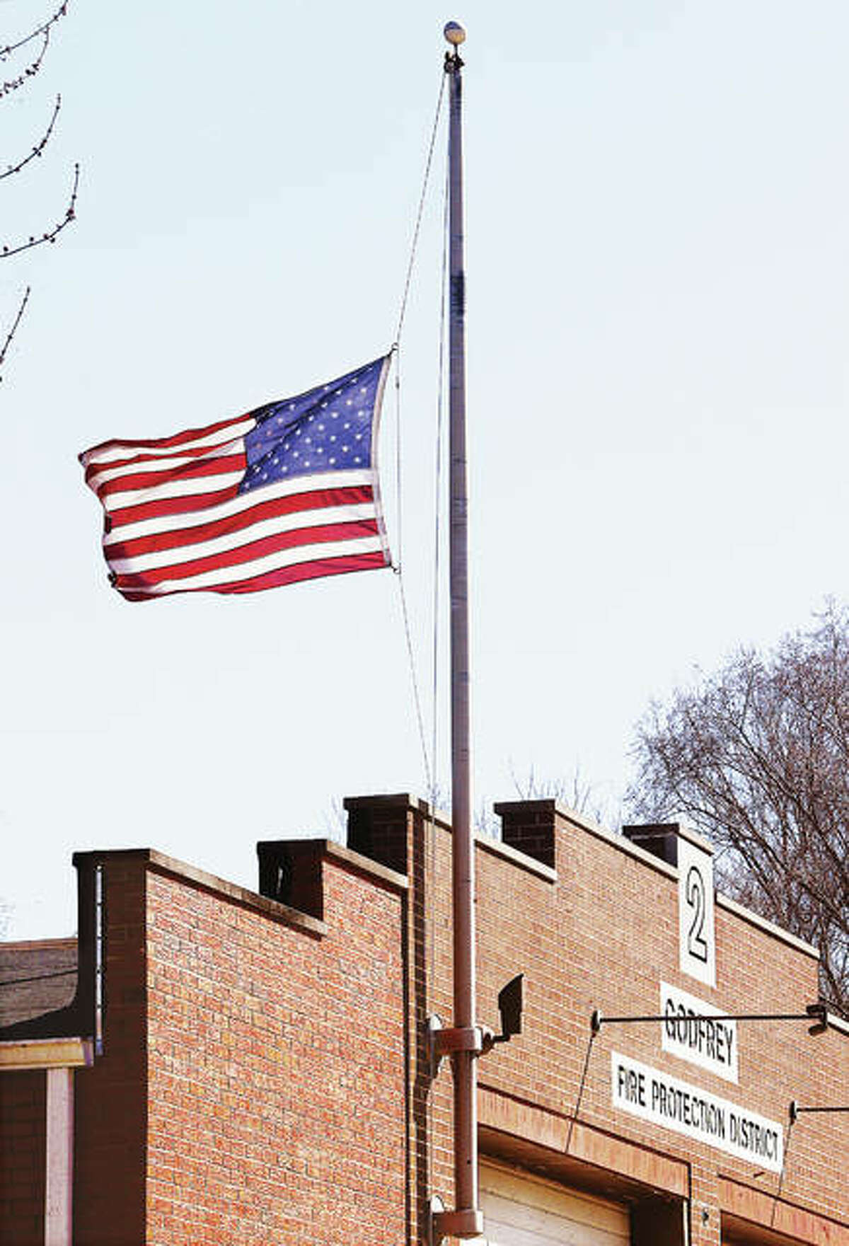 The flag at Godfrey Fire Station 2 flies at half staff Thursday in honor of Godfrey Fire Capt. Jake Ringering on the one-year anniversary of his death, March 5, 2019, while fighting a fire near Bethalto. Ringering, who was 37, died when a wall collapsed, killing him and injuring three other firefighters. His family and Godfrey firefighters on Wednesday held a private remembrance late Thursday afternoon at Station 2 where Ringering worked.