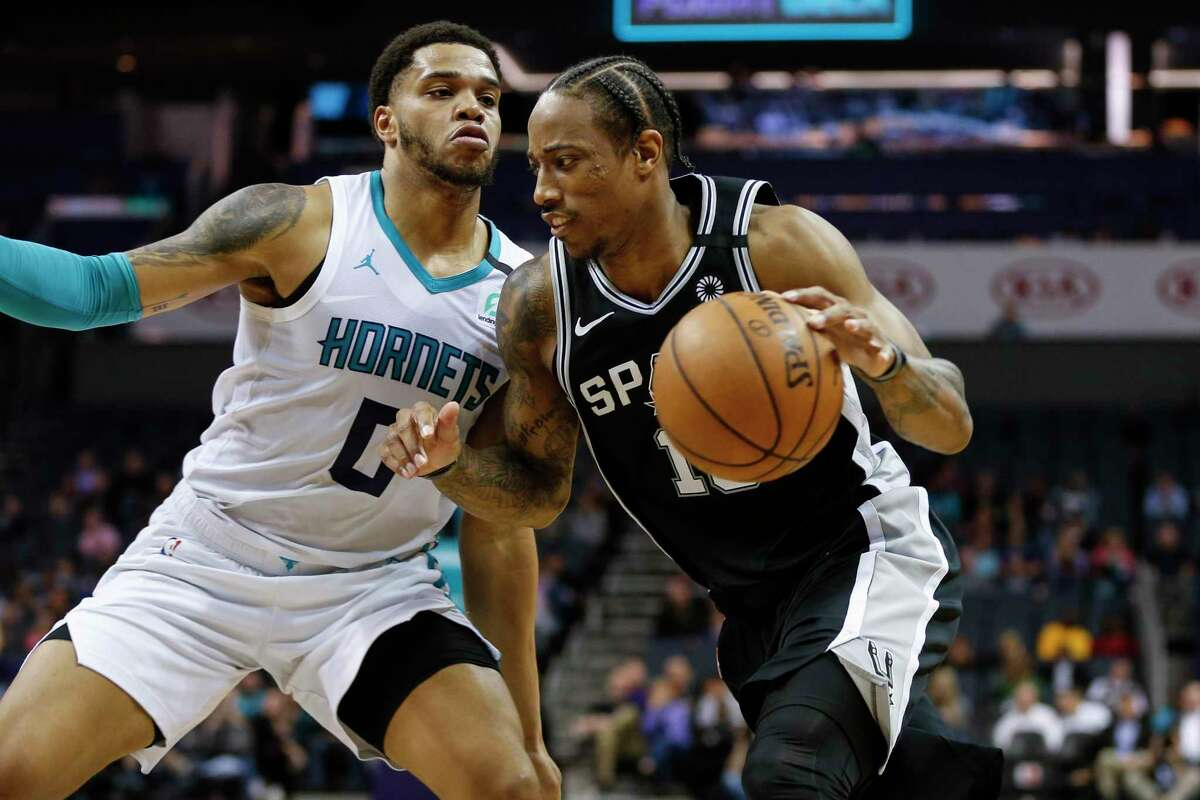 San Antonio Spurs forward DeMar DeRozan, right, drives into Charlotte Hornets forward Miles Bridges during the second half of an NBA basketball game in Charlotte, N.C., Tuesday, March 3, 2020. San Antonio won 104-103. (AP Photo/Nell Redmond)