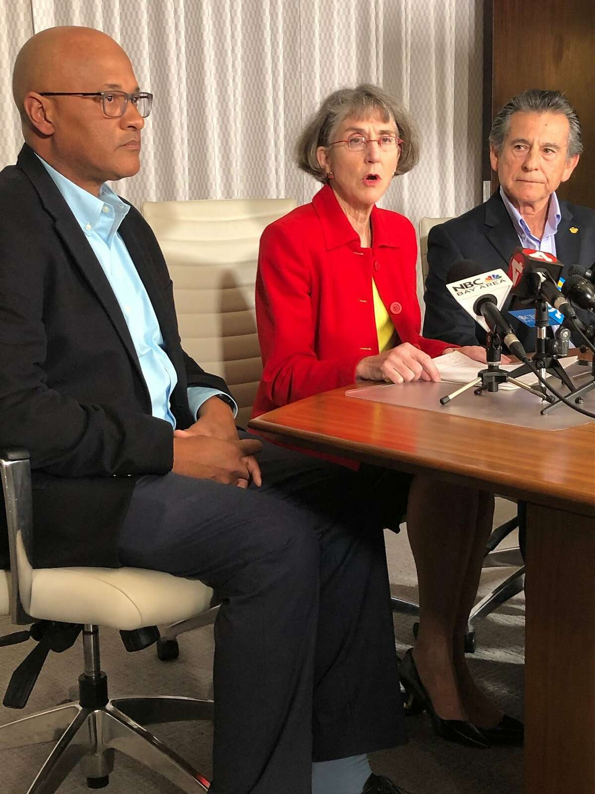 Flanked by former Oakland Police Chief Howard Jordan and Oakland city Councilman Noel Gallo, fired Oakland police Chief Anne Kirkpatrick calls for the removal of Oakland police monitor Robert Warshaw at a downtown Oakland press conference on Thursday, March 5, 2020.