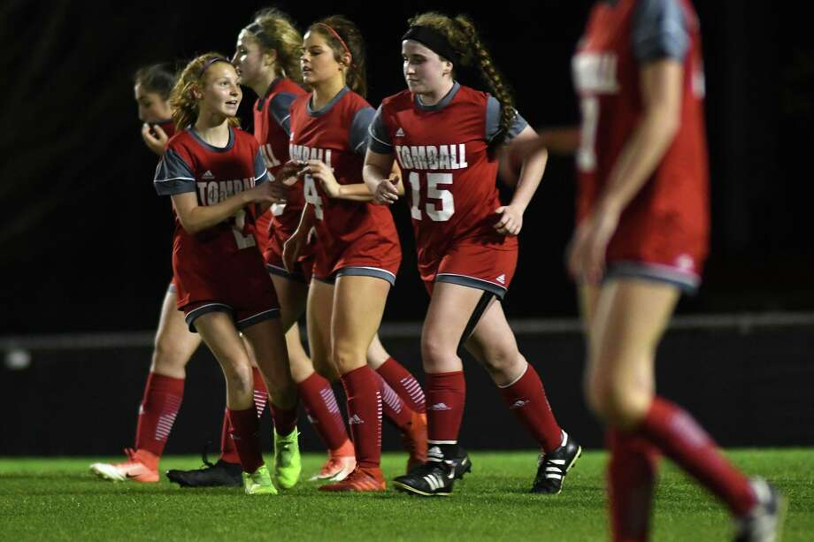 Tomball's Kendall Hall (2) congratulates teammate Courtney Heckt (4) on her goal scored against Montgomery during the second period of their District 20-5A matchup at THS on Feb. 18, 2020. Photo: Jerry Baker, Houston Chronicle / Contributor / Houston Chronicle