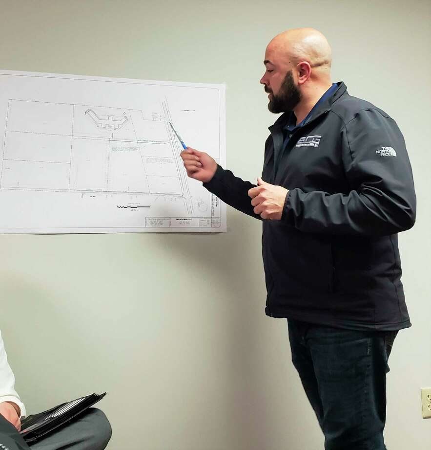 Rod Barriger, president of BCG Construction, presented plans for an assisted living center along US 31 and answered questions from the public during a Manistee Township Planning Commission meeting Wednesday. (Arielle Breen/News Advocate)
