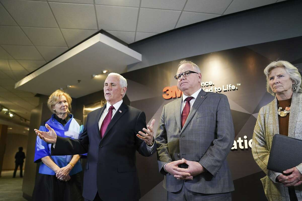 Vice President Mike Pence and Minnesota Governor Tim Walz speak to the press after Pence visited 3M World Headquarters in Maplewood, Minnesota, Thursday, March 5, 2020 meeting with 3M leaders and Minnesota Governor Tim Walz to coordinate response to the COVID-19 virus. On the left is Dr. Deborah Birx, ambassador and White House Coronavirus response coordinator. On the right is MDH Commissioner Jan Malcolm. (Glen Stubbe/Star Tribune via AP)