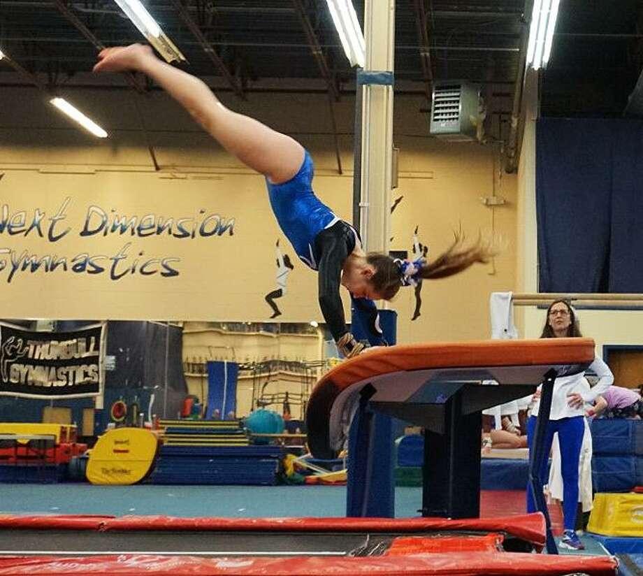 Darien's Lana Schmidt competes on the vault during the Blue Wave's meet in Trumbull in January. Photo: Darien Gymnastics / Contributed / Darien Gymnastics