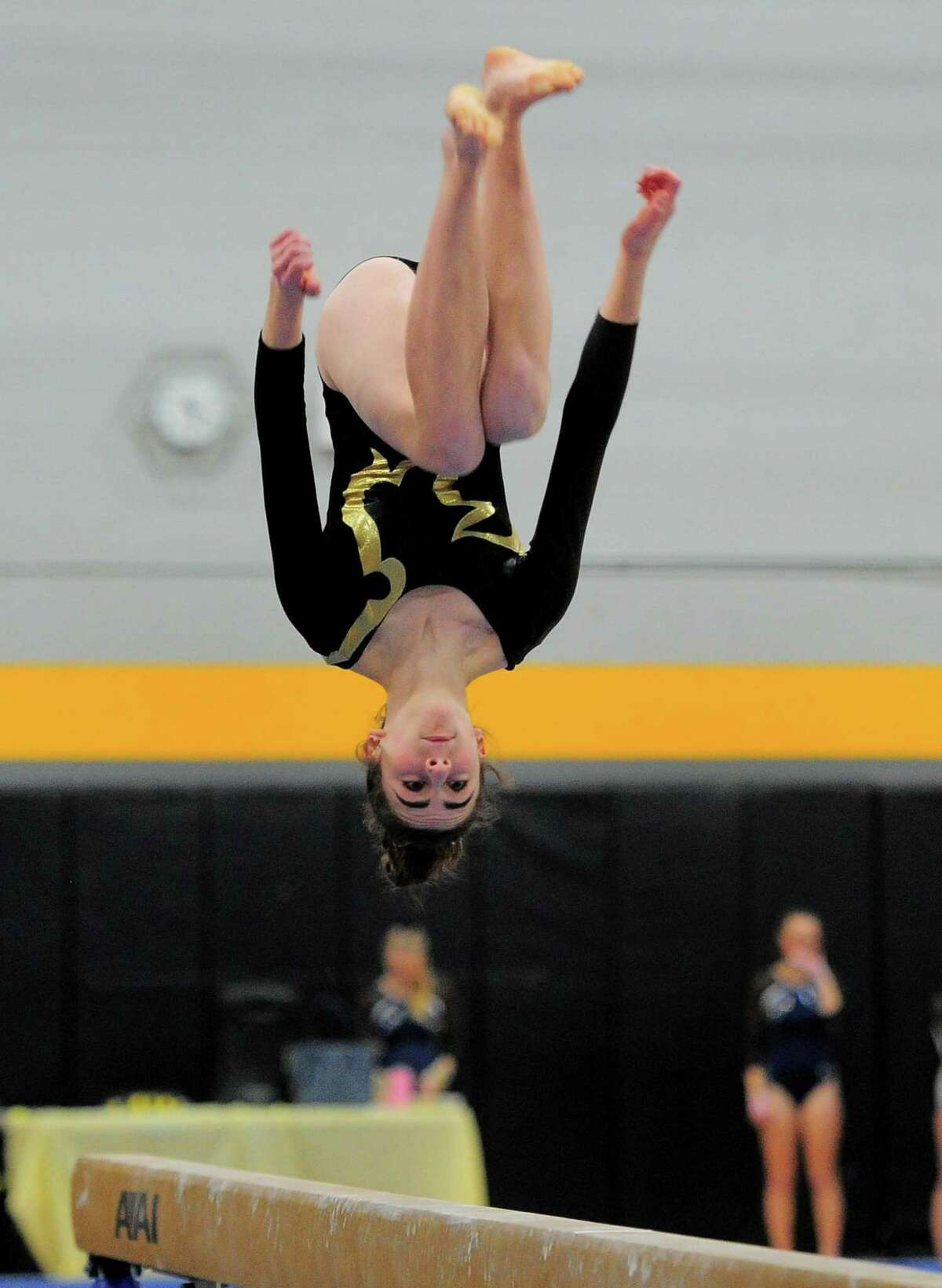Law's Catherine Burns competes on the balance beam during the Class S championship in 2019.