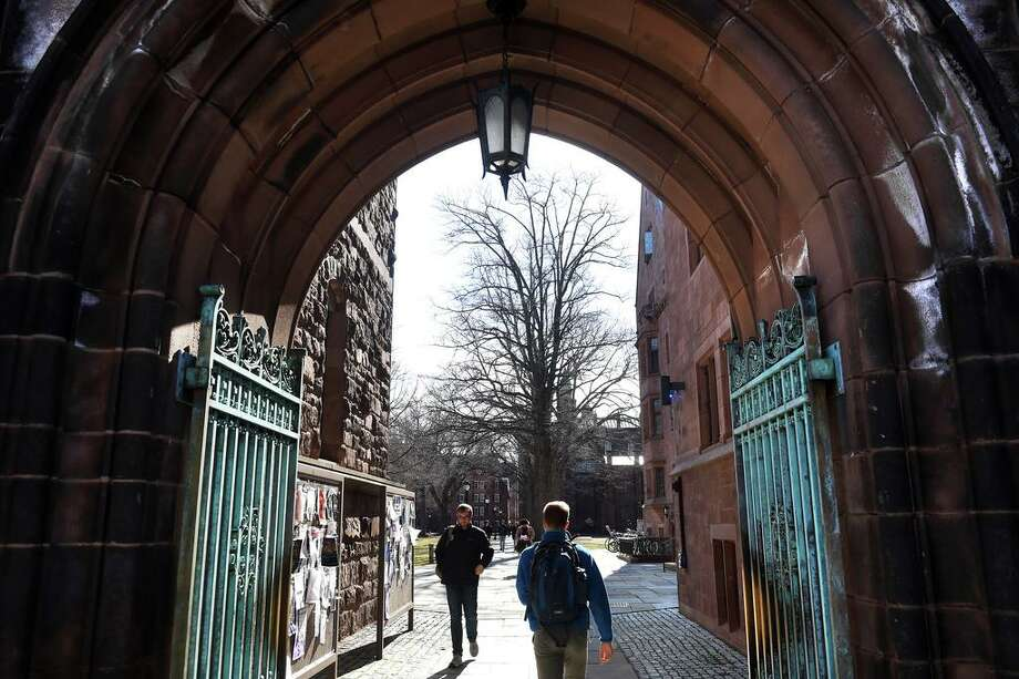 Students walk through an entrance to Yale University's Old Campus in New Haven on March 5, 2020. Photo: Arnold Gold / Hearst Connecticut Media / New Haven Register