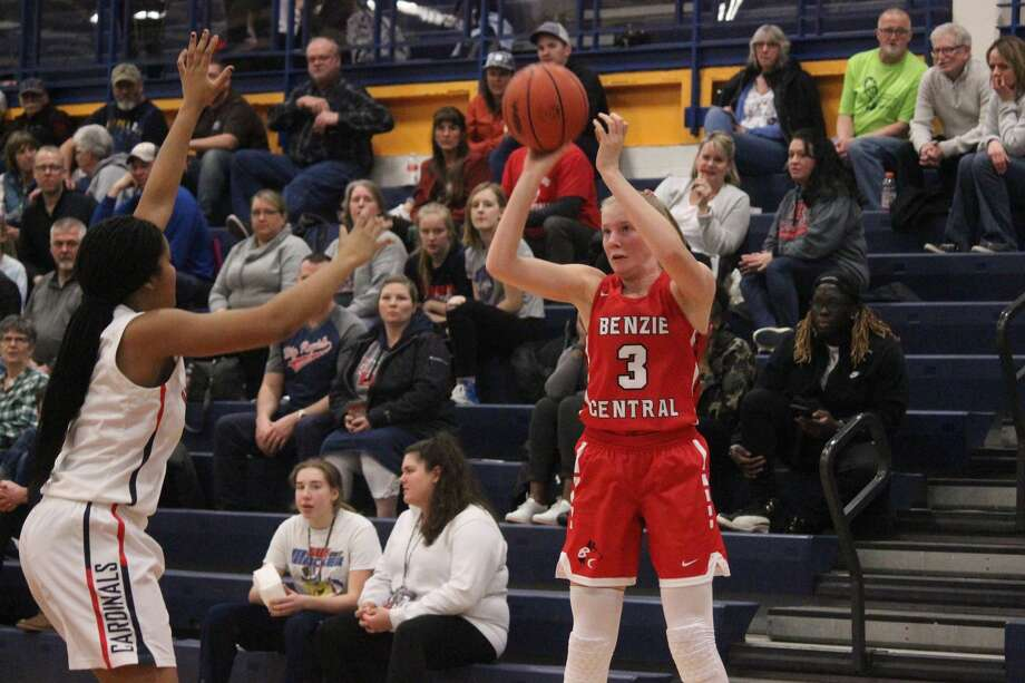 Jenna Cole takes a corner three during the first quarter of Benzie Central's loss to Big Rapids on March 4. Photo: Robert Myers