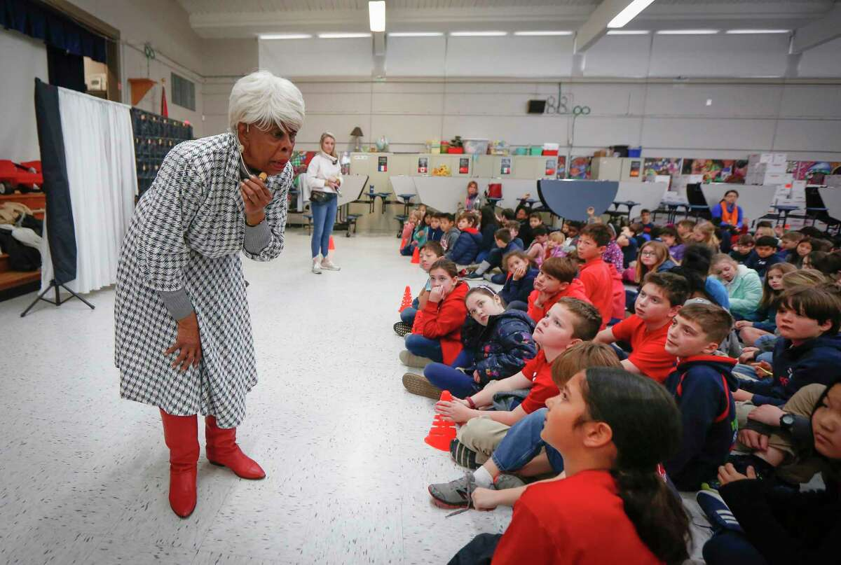 """Naomi Mitchell Carrier performed passages of the """"I Am Annie Mae - Musical"""" for students at Kolter Elementary School Friday, Feb. 21, 2020, in Houston."""
