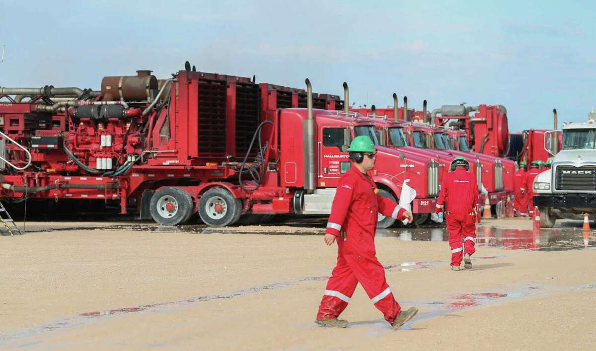 Halliburton hydraulic fracturing pumping units line a row near three pads Monday, June 26, 2017, in Midland.