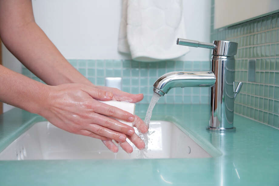 Regular and effective hand washing is critical to preventing the spread of colds and viruses. Photo: Tribune File Photo