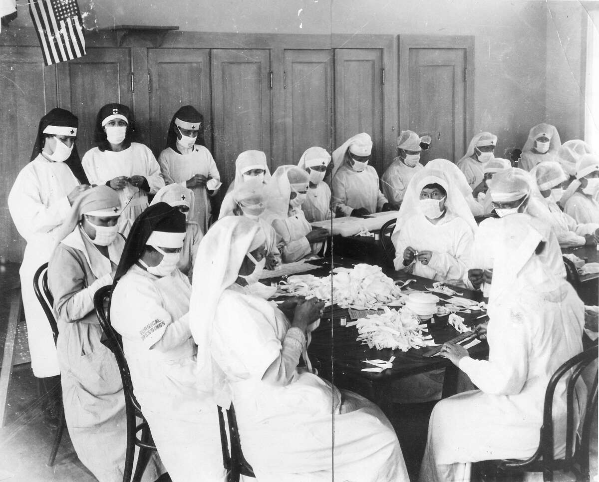 1918: Volunteers in Oakland sew masks to prevent the spread of the flu, during the deadly Spanish influenza of 1918 and 1919.