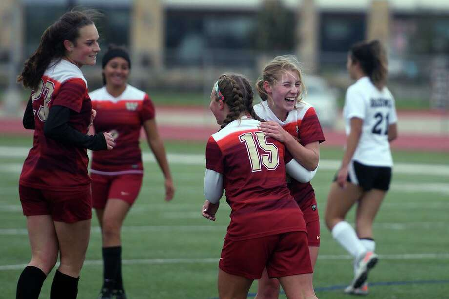 Cy Woods soccer players celebrate a goal during a District 14-6A matchup. The Lady Wildcats are one of the top teams in the 14-6A standings under head coach under Amy Trocquet. Photo: CFISD