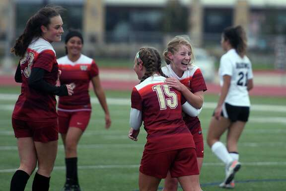 Cy Woods soccer players celebrate a goal during a District 14-6A matchup. The Lady Wildcats are one of the top teams in the 14-6A standings under head coach under Amy Trocquet.