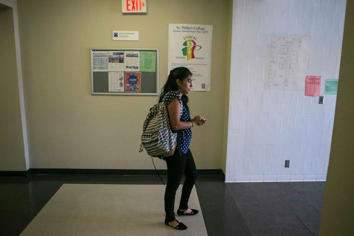 Destiny Herrera, 21, waits for her boyfriend to pick her up from class at St. Philip's College in 2018.