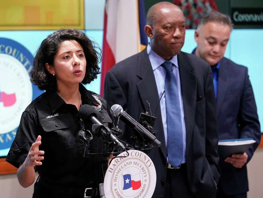 Harris County Judge Lina Hidalgo, left, speaks as Houston Mayor Sylvester Turner, and Dr. Umair Shah, executive director of Harris County Public Health, right, listen about the first two cases of coronavirus in Harris County during media conference at Houston Transtar Thursday, March 5, 2020 in Houston. One man and one woman in the unincorporated area of northwest Harris County tested positive for COVID-19, according to county officials. Both patients, and the man in Fort Bend county that tested positive for COVID-19, had traveled together to Egypt. Photo: Melissa Phillip, Staff Photographer / © 2020 Houston Chronicle