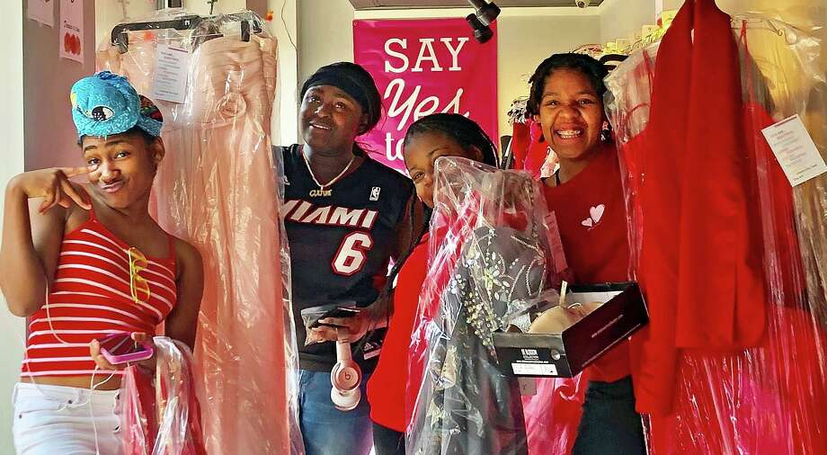 These shoppers look happy with their gowns at last year's pop-up boutique, part of Say Yes to the Prom Dress. Photo: Contributed Photo