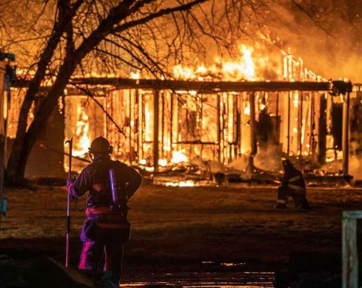 Area firefighters battle a rural fire unrelated to recent blazes in Macoupin County suspected as arson.