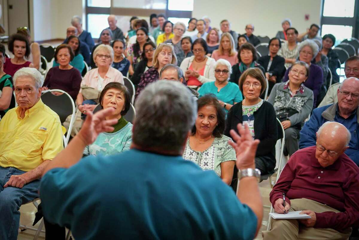 A full meeting room of seniors listen as Dr. Joe A. Anzaldua, a Sugar Land family physician, talks about how they can better prepare themselves against coronavirus Thursday, March 5, 2020, at T.E. Harman Center in Sugar Land.