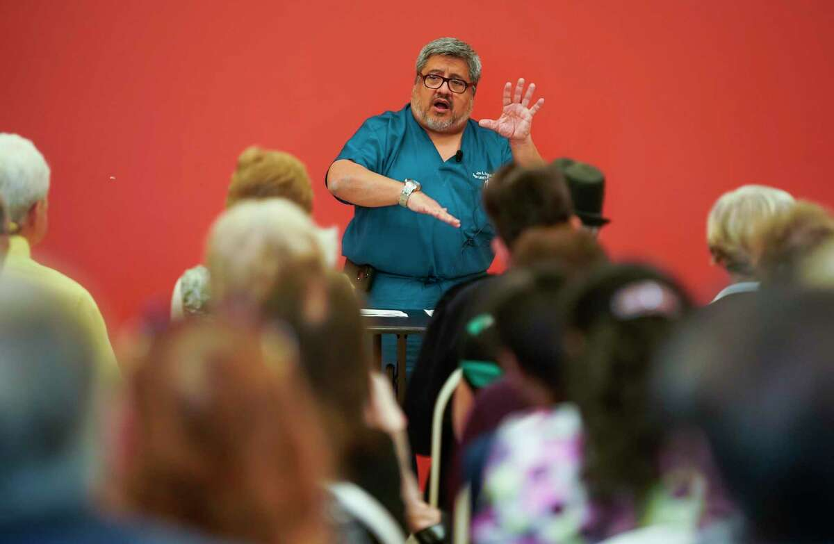 Dr. Joe A. Anzaldua, a Sugar Land family physician, speaks to a roomful of seniors about how they can better prepare themselves against coronavirus Thursday, March 5, 2020, at T.E. Harman Center in Sugar Land.