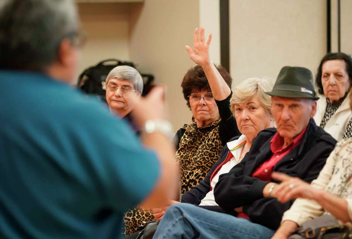 Older residents ask questions of Dr. Joe A. Anzaldua about how they can better prepare themselves against coronavirus on March 5, 2020, at T.E. Harman Center in Sugar Land.