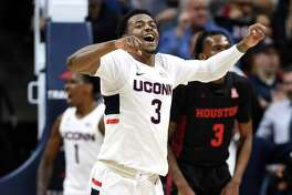 Connecticut's Alterique Gilbert reacts to a play in the first half of an NCAA college basketball game against Houston, Thursday, March 5, 2020, in Storrs, Conn. (AP Photo/Jessica Hill)