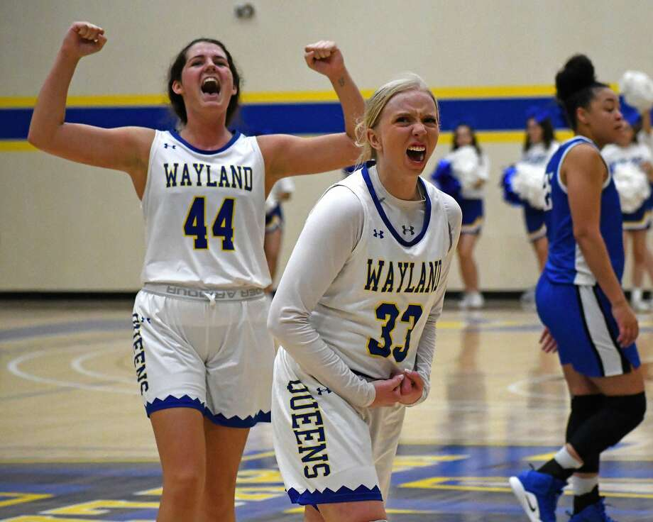 Wayland Baptist players Jenna Cooper (33) and Kelea Pool celebrate the team's 65-50 win over Oklahoma City on Thursday, Feb. 27, 2020 in the Hutcherson Center. The fifth-ranked Flying Queens and top-ranked Stars are the heavy favorites heading into this weekend's Sooner Athletic Conference women's basketball tournament. The semifinals will be played on Friday and the finals are set for Saturday inside the Hutcherson Center. Photo: Nathan Giese/Planview Herald